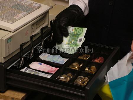 efectivo teclado guante monedas billete de
