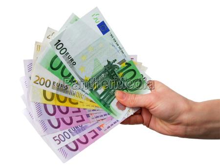 mano con billetes en euros