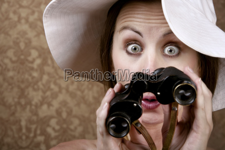 woman with sunglasses and binoculars