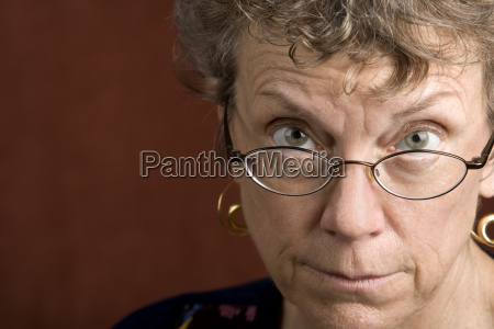 woman looking over her glasses