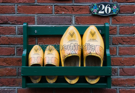 storage rack with clogs next to