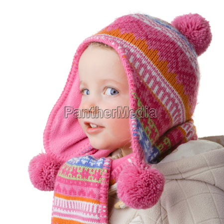 child with scarf and hat