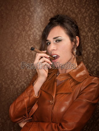 woman in dark leather coat with