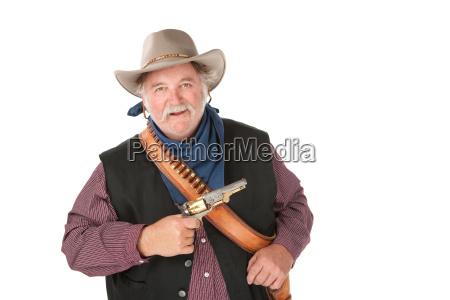 vaquero resistente grande con el arma