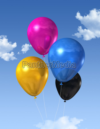 cmyk colored balloons on a blue