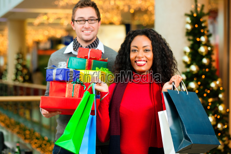 couple making shopping for christmas