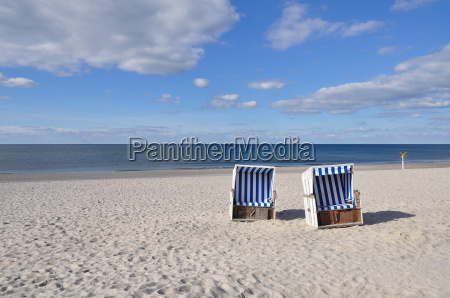 two beach chairs by the sea