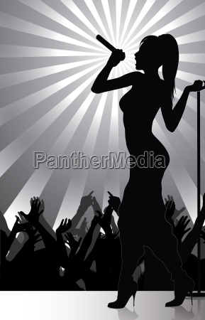 pop singer performing on stage with