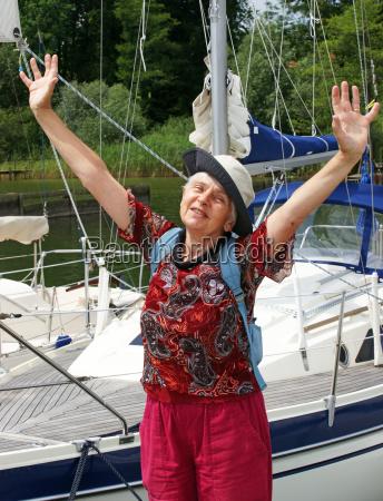 happy senior sailing senior with sailboat