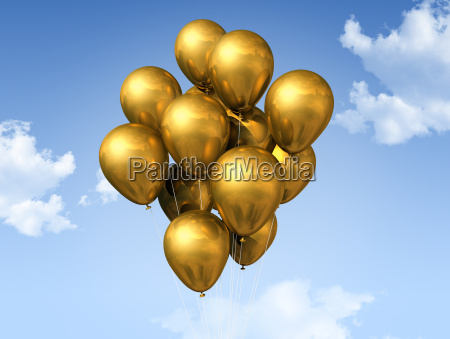 gold balloons on a blue sky