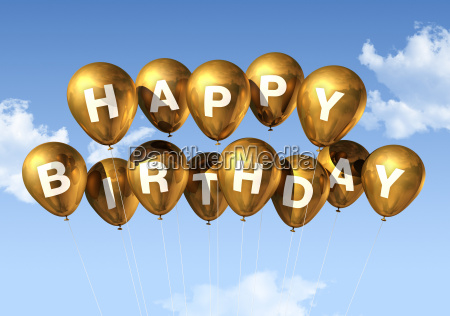 gold happy birthday balloons in the
