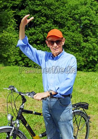 happy senior with bicycle