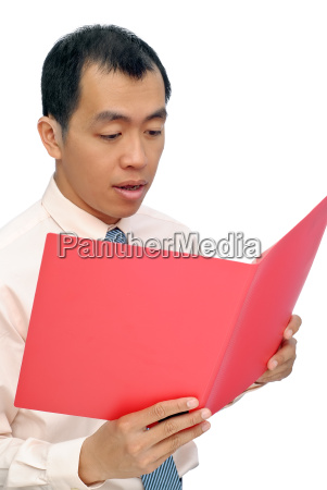 surprised business man reading paper