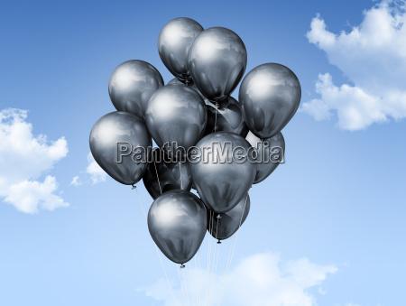 silver balloons on a blue sky