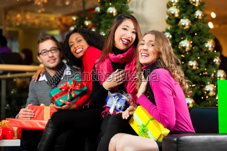 friends at christmas in shopping mall