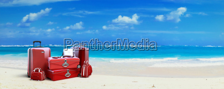 red luggage at the beach
