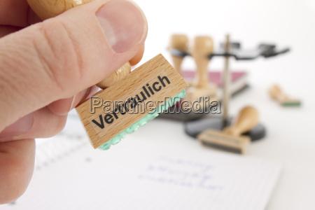 sello con inscripcion confidencial
