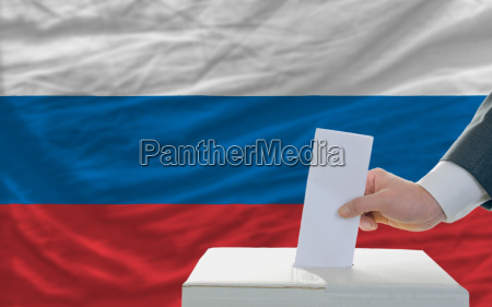 man voting on elections in russia