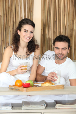 couple eating lovely breakfast