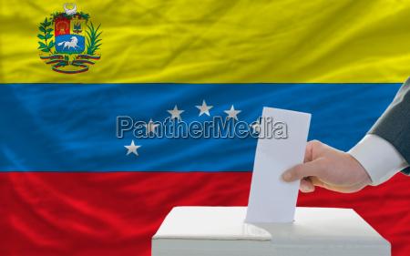 man voting on elections in venezuela