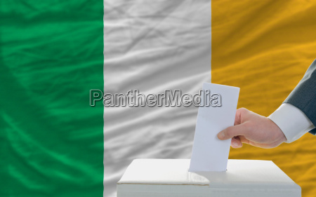 man voting on elections in ireland