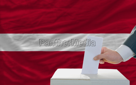 man voting on elections in latvia