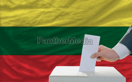 man voting on elections in lithuania