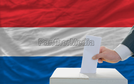 man voting on elections in netherlands