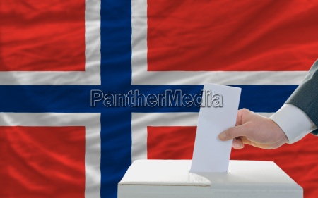 man voting on elections in norway