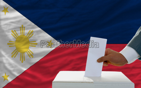 man voting on elections in phillipines