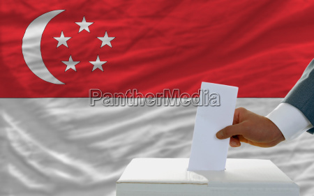 man voting on elections in singaporel