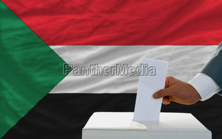 man voting on elections in sudan