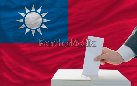 man voting on elections in taiwan