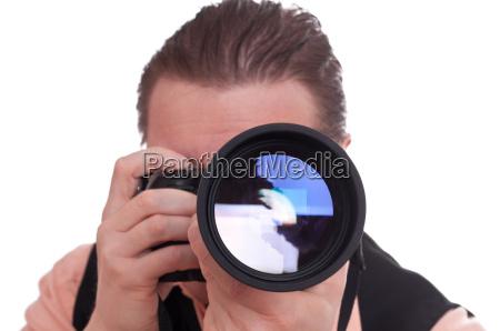 fotografo con camara y teleobjetivo
