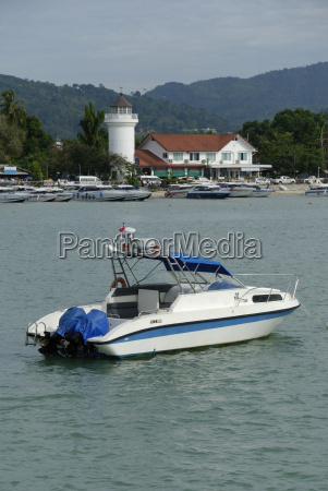 tailandia motora faro barco con remos
