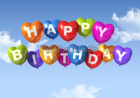 happy birthday heart shape balloons in