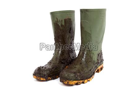botas de agua con barro