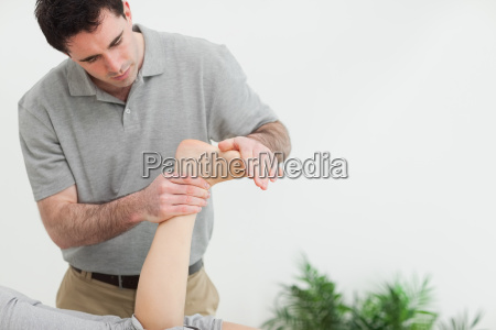 brown haired therapist stretching the foot