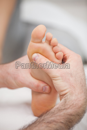 sole of foot being massaged in