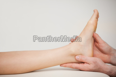 chiropodist holding the foot of a