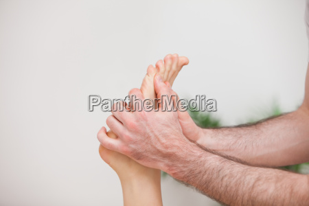 doctor manipulating the foot of his