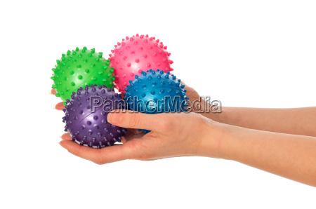 cuatro bolas de masaje de colores