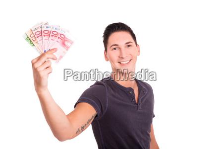 hombre feliz joven con billetes de