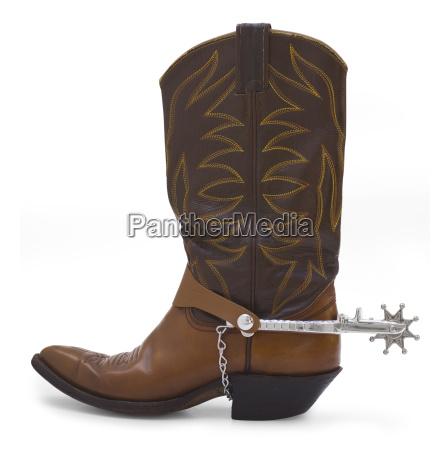 bota de vaquero y espuela