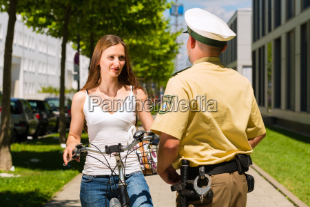 woman on bike with policeman in