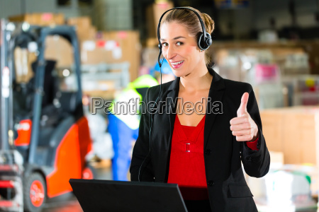 woman with headset in a warehouse
