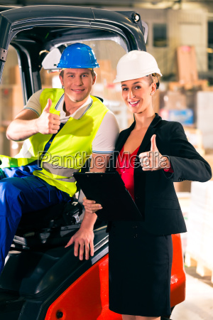 forklift driver and colleague in storage