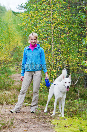 the woman with a dog walk