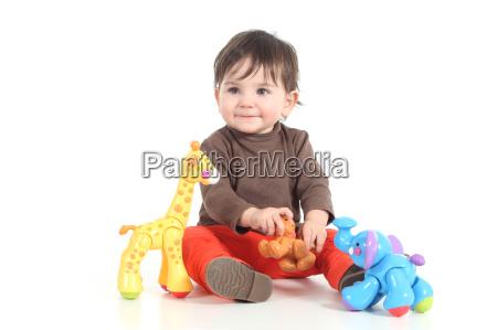 bebe jugando con juguetes de colores