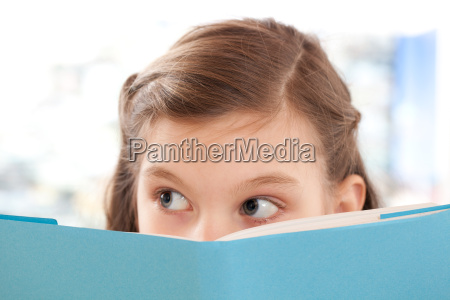 girl reads a book at school